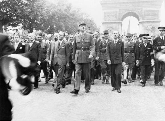 General de Gaulle and his entourage proudly stroll down the Champs Élysées to Notre Dame Cathedral for a Te Deum ceremony following the city's liberation on August 25, 1944.