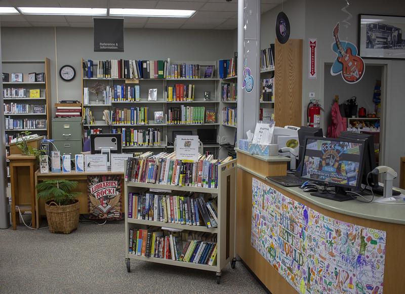 Circulation desk, book sale, and information desk