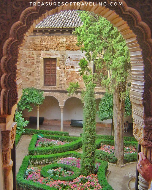 One of the many beautiful courtyards within the gardens of the Alhambra, which is a palace and fortress complex located in Granada, Spain. The architecture, the gardens and the backdrop of the Sierra Nevada Mountains in the background make this fortress a
