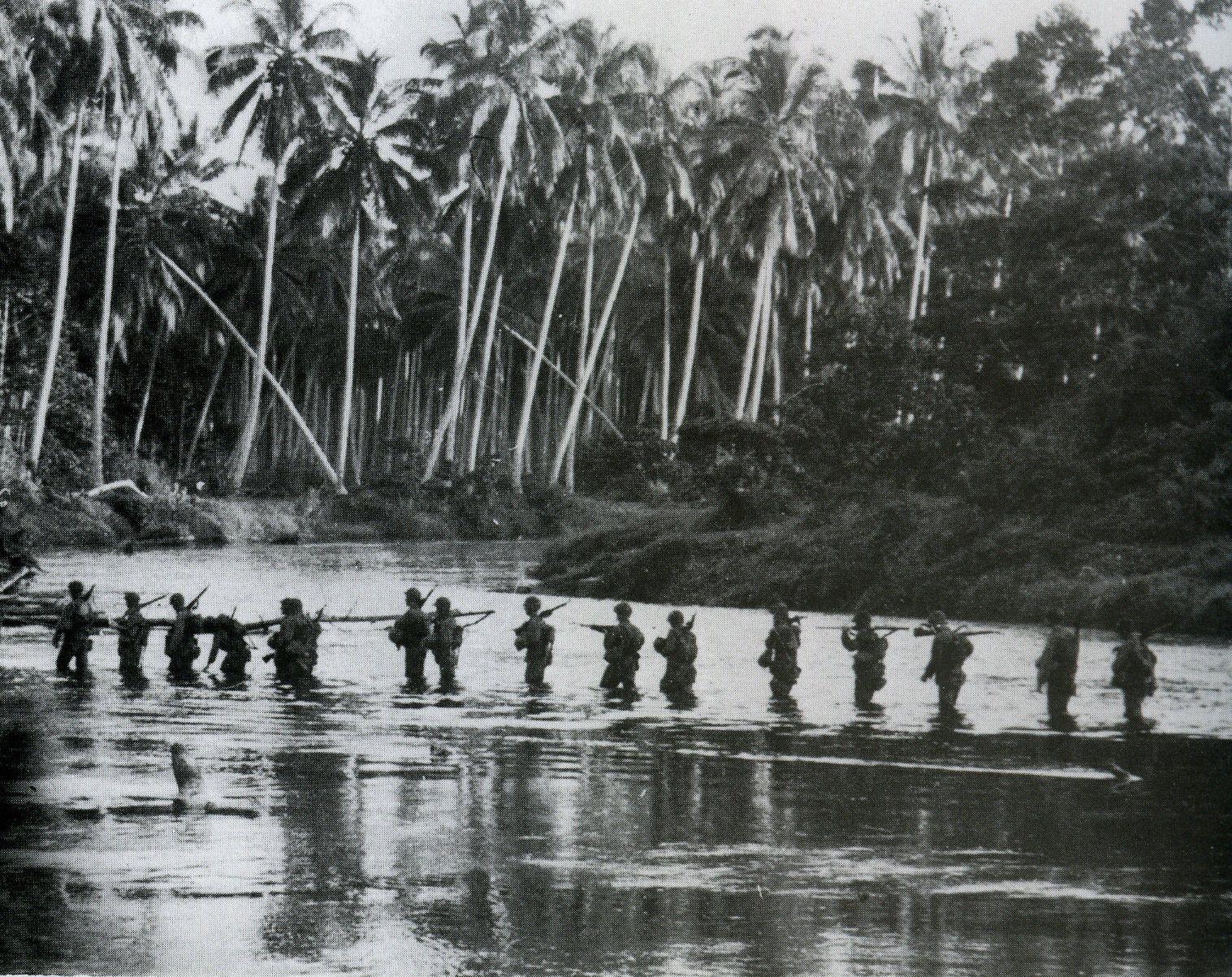 A U.S. Marine patrol crosses the Matanikau River on Guadalcanal in September 1942.