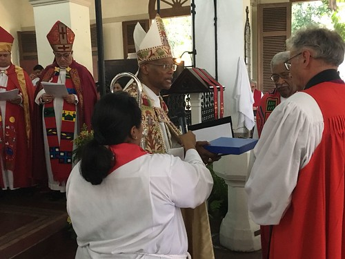The Bishop of Coventry Christopher Cocksworth presents Archbishop Julio Murray with a plate embossed with the Compass Rose symbol of the Anglican Communion