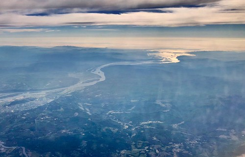perspective colors white ground blue start mouth reflecting reflection northwest nature curves bend clouds horizon skyline sky sunlight sun west coast ocean pacific land water or wa flyover flying geography overhead flight above altitude washington vancouver oregon portland columbiariver