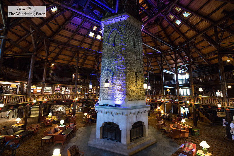 Interior of the large lobby with the fireplace as the heart