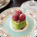 Pistachio financier topped with fresh raspberries