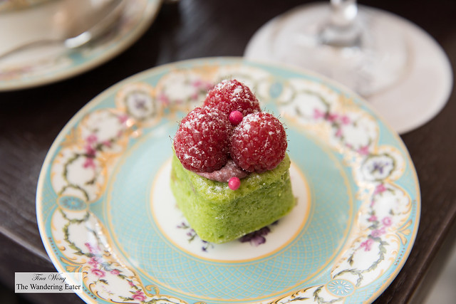 Pistachio financier topped with fresh raspberries