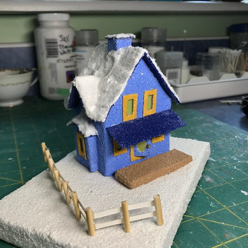 Blue Putz with snow covered roof