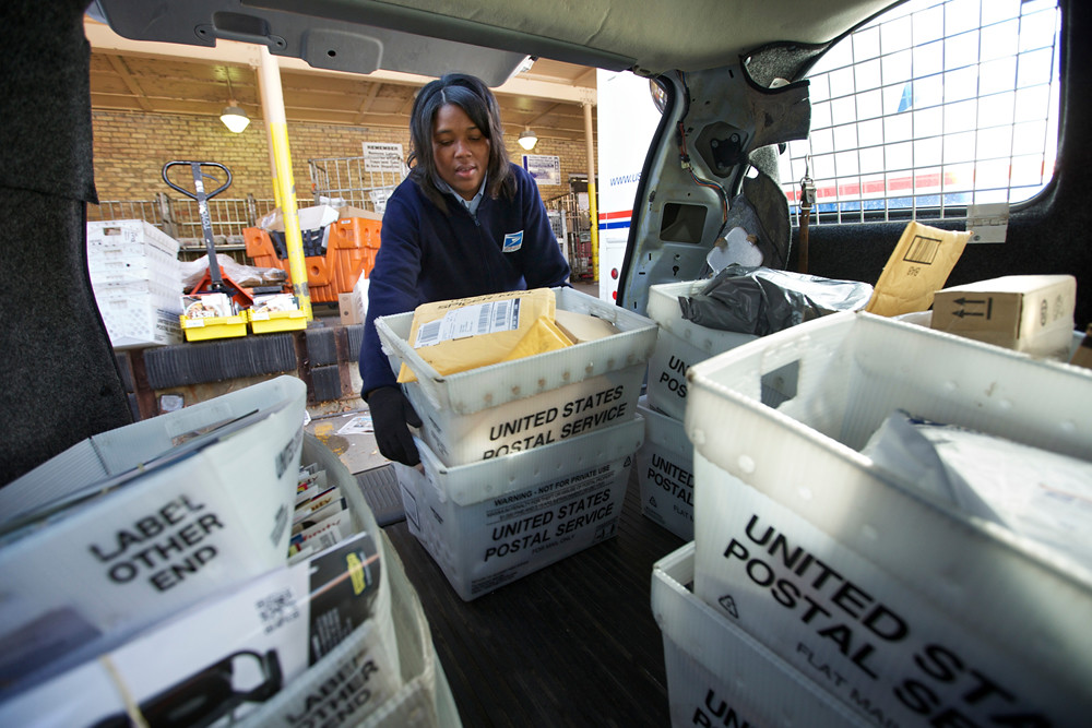 United States Postal Service Letter Carrier Lakesha Dortch-Hardy loads her van with mail at the Lincoln Park carriers annex in Chicago, Photo taken on November 29, 2012.