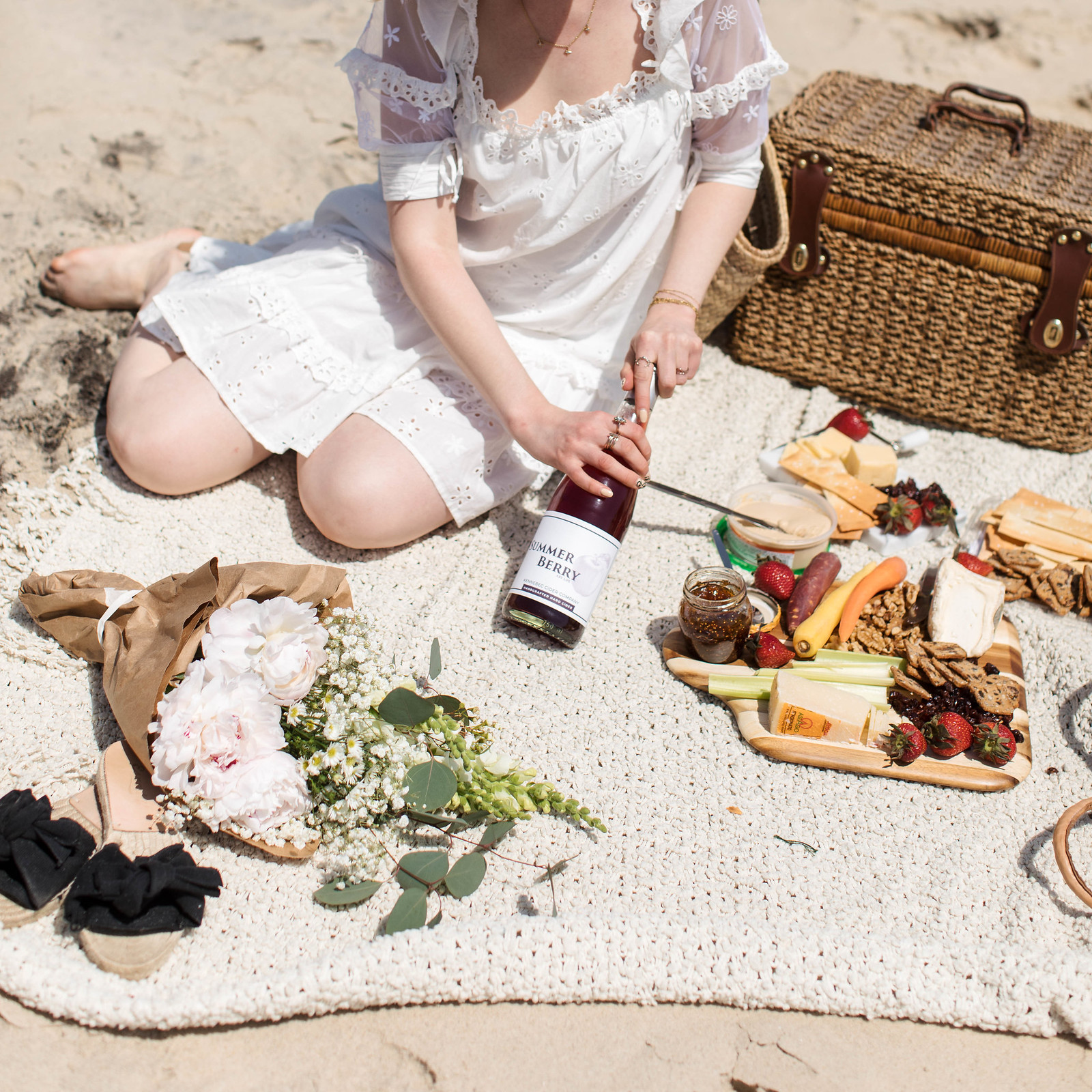 Summer Beach Picnic with peonies a vintage picnic basket cider wine a cheese board and crudites on juliettelaura.blogspot.com