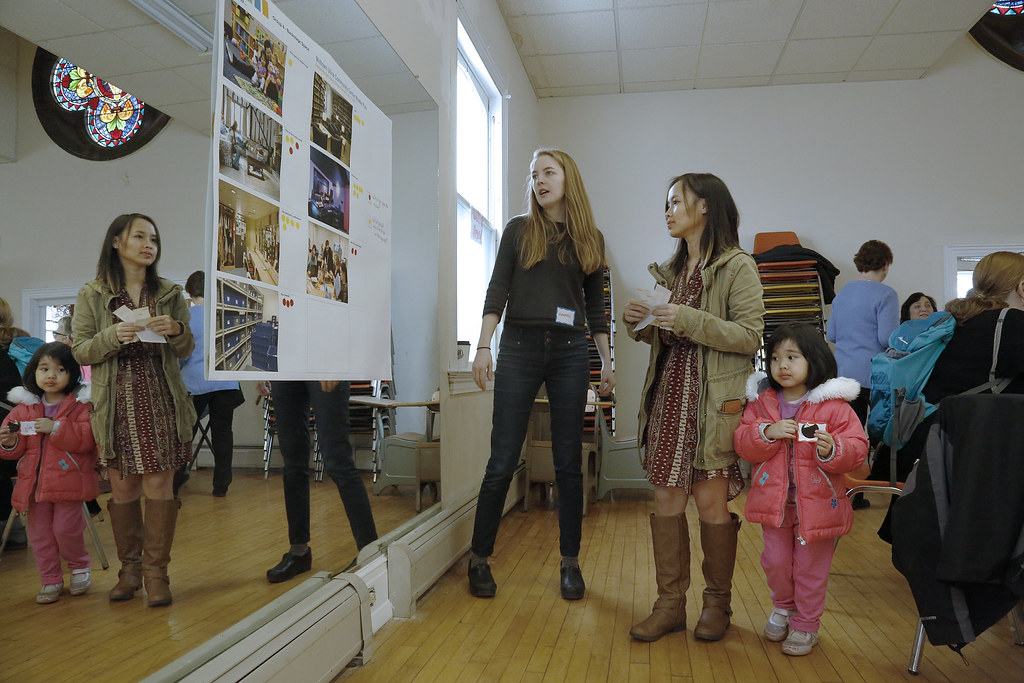 Hannah Plummer (M.R.P. '18), center, introduces visitors to the visual displays.