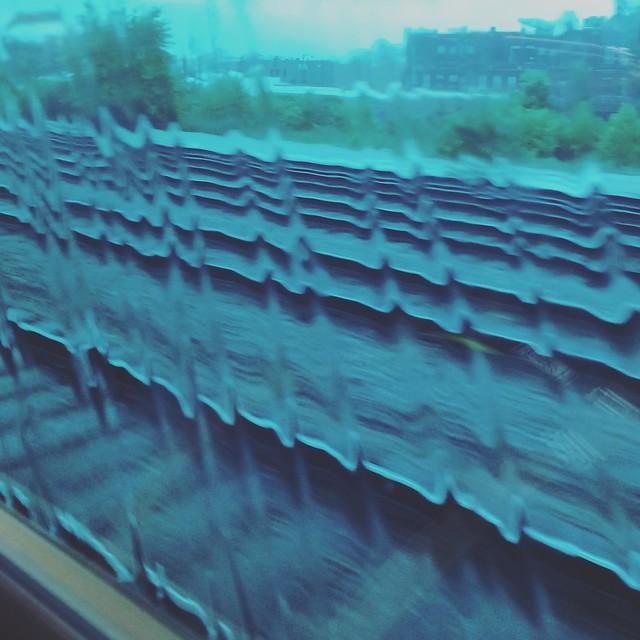 Train tracks as heartbeat from rain drops on window
