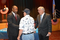 Reps. Storms and Gibson pin a recipient of the Wartime Service Medal