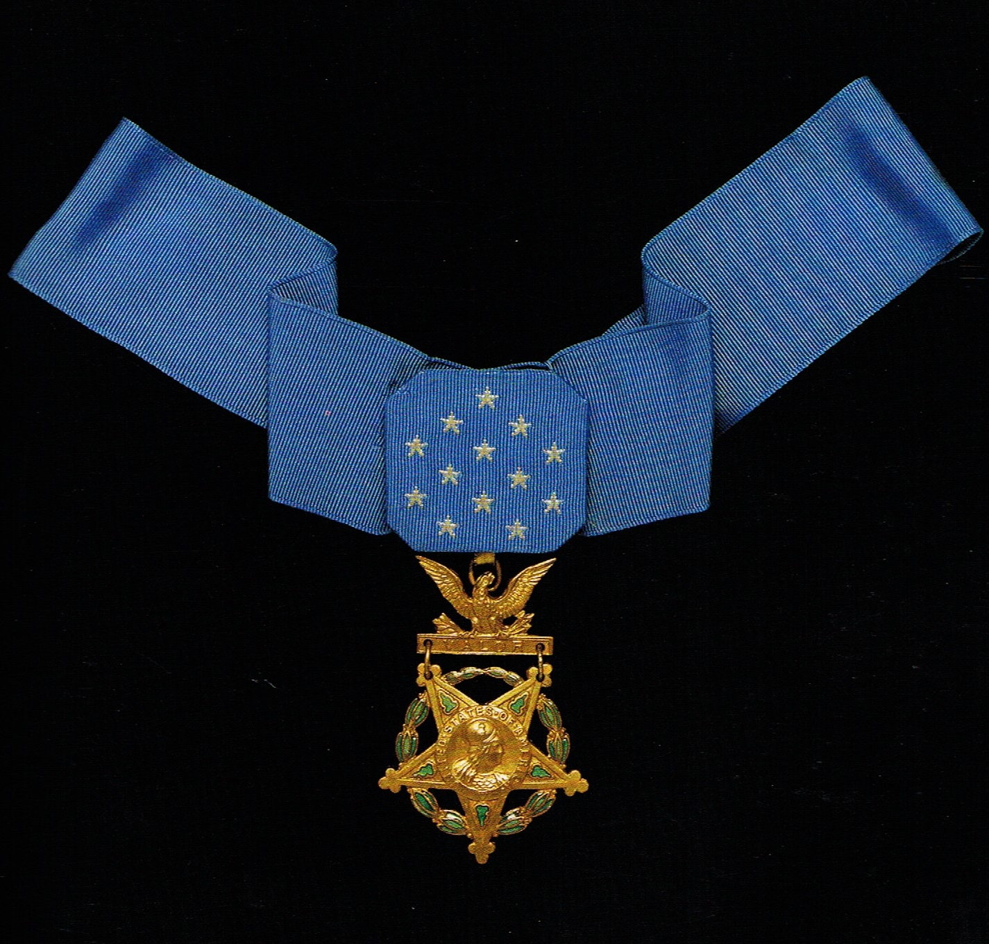 """In the center of the Army Medal of Honor is the head of Minerva, surrounded by the words """"United States of America."""" The reverse side of the medal is inscribed """"The Congress to"""" with the recipient's name."""
