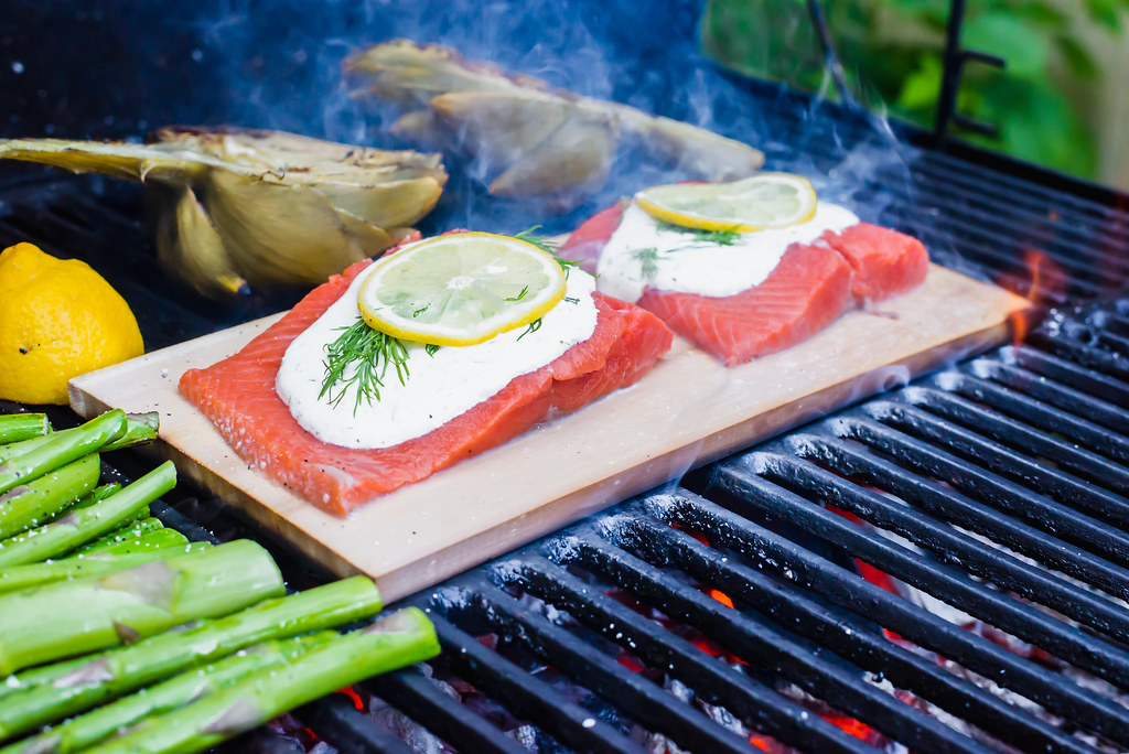 Cedar Plank Salmon is perfect for the grill along with other vegetables.
