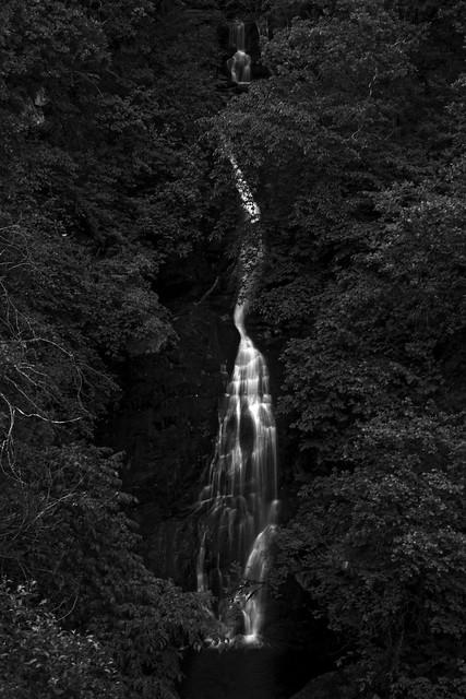fine art black & white, dark, moody, shot of the dramatic Black Spout Waterfall, Pitlochry, Perth & Kinross, Scotland