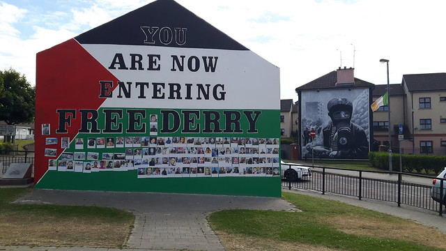 "A wall painted in red, green and white with the words ""You are now entering Free Derry"""