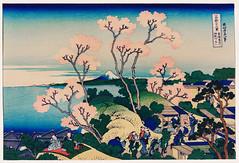 Goten-Yama Hill, Shinagawa on the Tokaido by Katsushika Hokusai (1760-1849) a traditional Japanese Ukyio-e style illustration of sakura blossom with Mount Fuji in the background and village people having a picnic and enjoying life. Digitally enhanced from