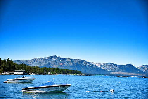 boats boat mountain mountainside mountains water lake blue sky