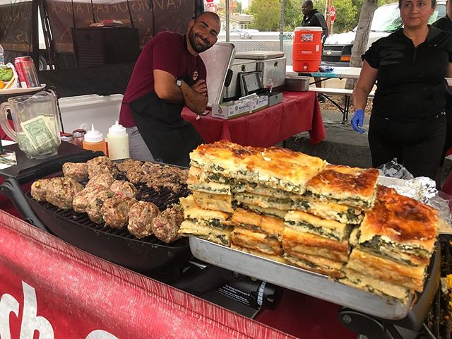 #kvpinmybelly Spanakopita and meat patties on the grill at Hillcrest Farmers Market. NOM!