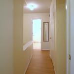 Upstairs hallway. Bathroom in the distance.