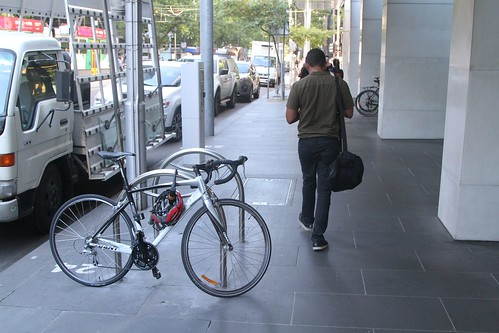 Bike racks running 90 degrees to the road and blocking the footpath at William and Bourke Street