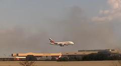 Emirates Airbus A380 A6-EOO avoiding grass fire London Heathrow Airpor