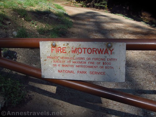 The sign at the beginning of the fire road, i.e., the