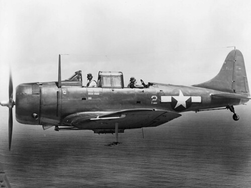 US Marine Corps Douglas SBD-6 Dauntless from Marine scoutbombing squadron VMSB-231 Ace of Spades flying from Majuro Atoll in early 1944.