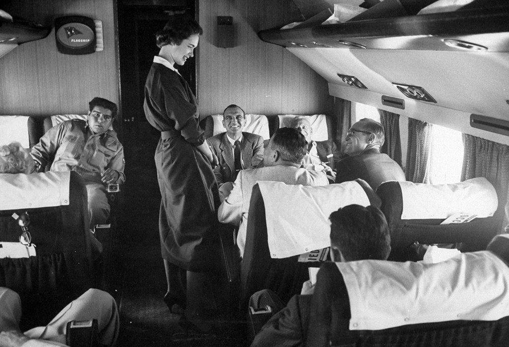 A stewardess speaking to men on a flight in 1958. (Peter Stackpole The Life Picture Collection Getty Images)