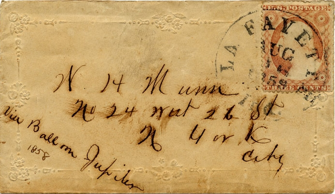 "Envelope carried aboard balloon Jupiter's flight from Lafayette, Indiana, which was forced to land in Crawfordville, Indiana, due to unfavorable wind conditions on August 17, 1859. The envelope and its enclosed letter make up the only known surviving piece of the first officially sanctioned U.S. airmail, out of a total of 146 pieces sent aboard the Jupiter. The sender marked the envelope ""via Balloon Jupiter,"" following published instructions by the Lafayette postmaster. The August 16 postmark marks the intended date of the ascent, which had to be delayed a day at the last minute due to a failed valve. At the bottom left corner of the envelope, a later hand incorrectly added the date 1858, a year before the actual flight. From the collection of the Smithsonian National Postal Museum, Washington, D.C."