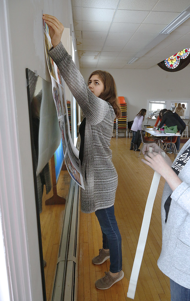 Chloe Rippe (B.S. URS '19) posts an interactive visual collage in preparation for the MUCC open house to assist participants in setting goals and priorities for the center.