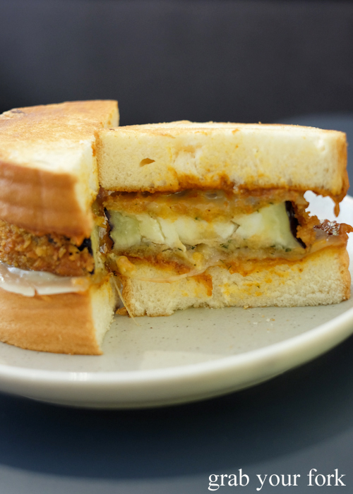Fried eggplant, romesco and provolone sandwich cross-section at A1 Canteen by Clayton Wells in Chippendale Sydney