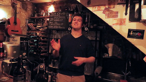 Bartender explaining the history of the Hole-in-the-Wall Pub in Kilkenny, Ireland