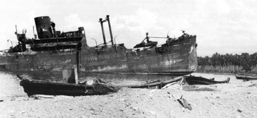 A Japanese transport destroyed by aircraft from Henderson Field at Tassafaronga, Guadalcanal on October 14, 1942.