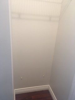 Freshly painted walk through closet