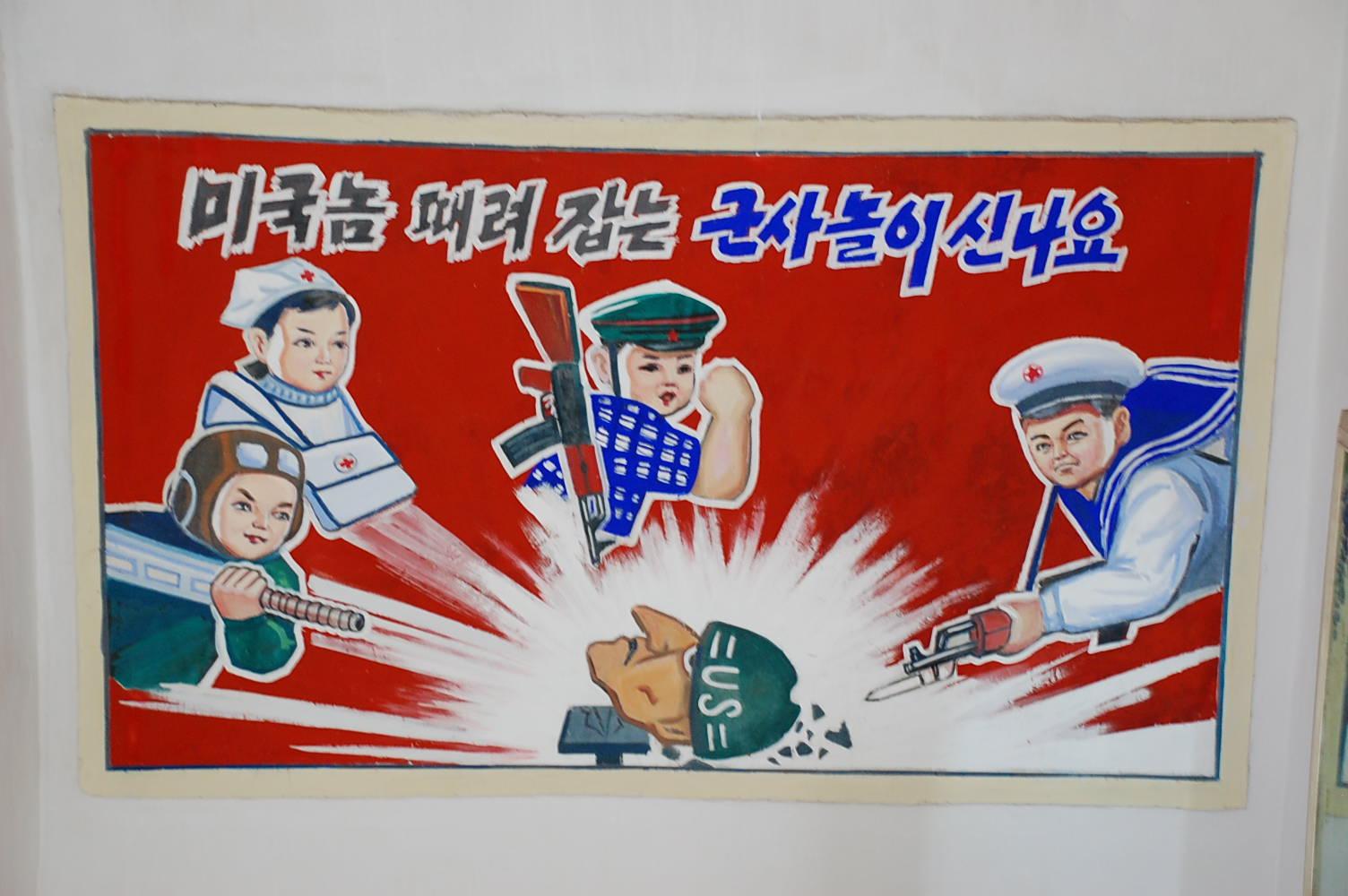 Propaganda poster in a primary school at the Chongsan-ri Farm, North Korea. Photo taken on June 10, 2008.