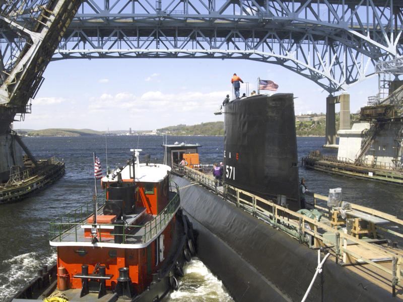 Groton, Conn., May 8, 2002 — Nautilus (SSN 571), the world's first nuclear powered submarine, leaves the Electric Boat Shipyard in Groton en route Naval Submarine Base New London. Nautilus underwent a five-month preservation at a cost of approximately $4.7 million. On Jan. 17, 1955, USS Nautilus put to sea for the first time and signaled her historic message