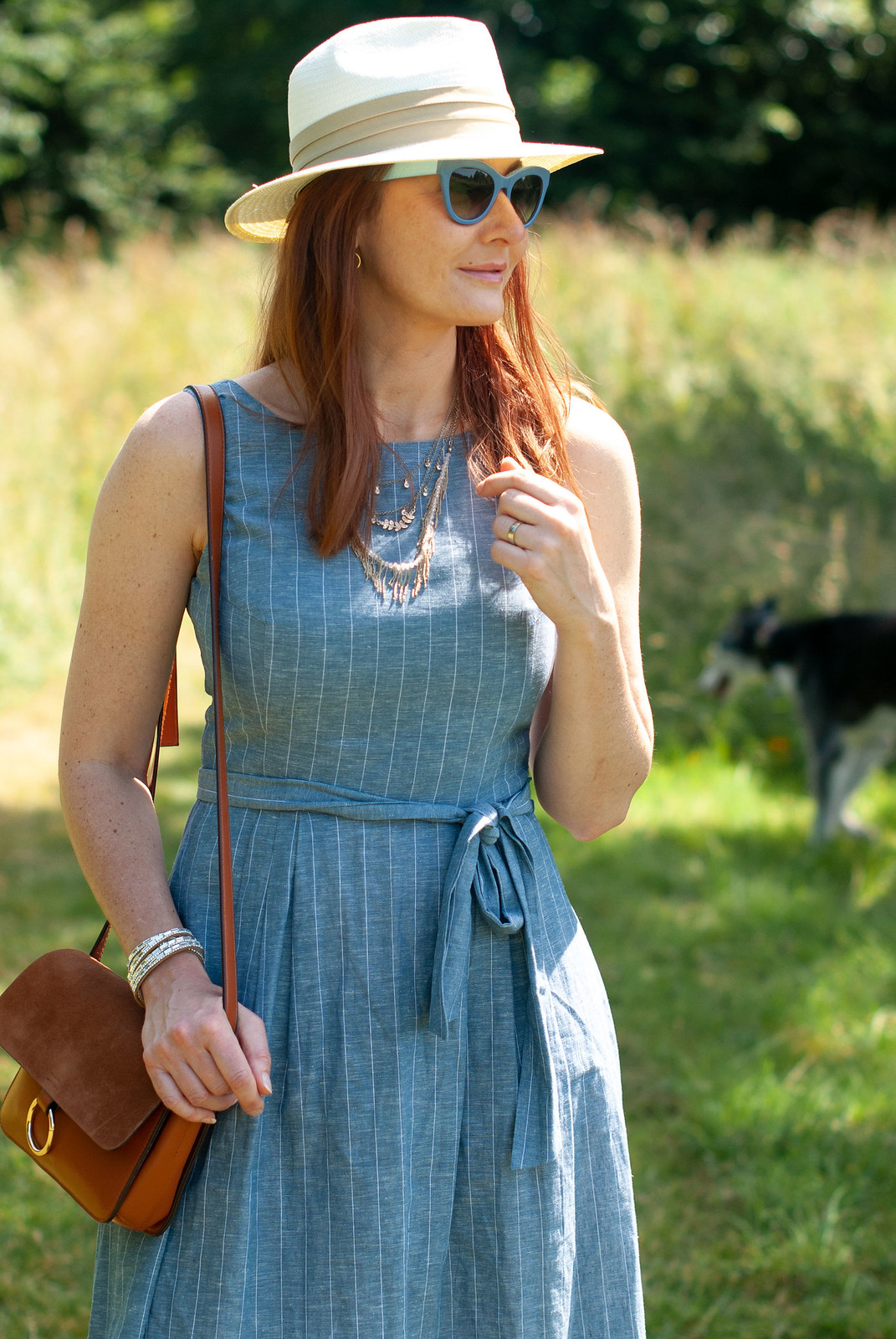 A Lightweight Chambray Dress Perfect for Summer \ styled with a cream Panama hat, tan crossbody bag, red wedge espadrilles and blue cat eye sunglasses | Not Dressed As Lamb, over 40 fashion