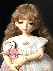Littlefee Lewi wearing hardcap mohair wig by Robbin Atwell, with doll by Julienne Stewart