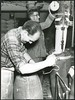 Two men bagging flour at the Crown Milling Company Limited, Dunedin, c1950