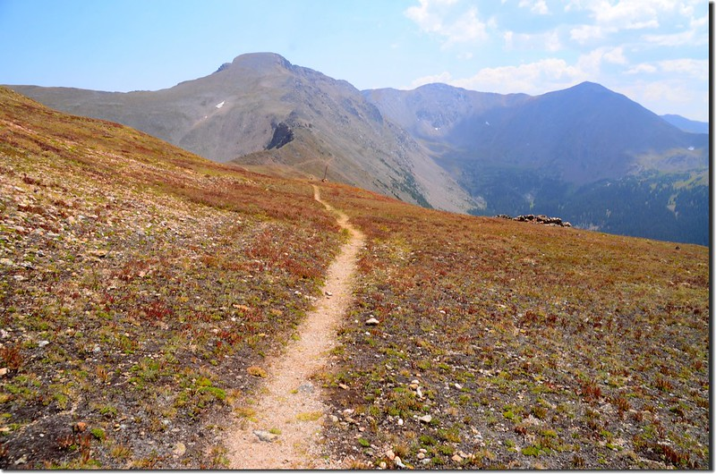 The route turns south on the Continental Divide Trail with great views south of James Peak
