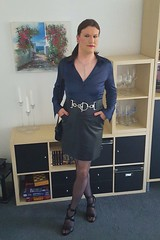 Satin blouse and leather skirt