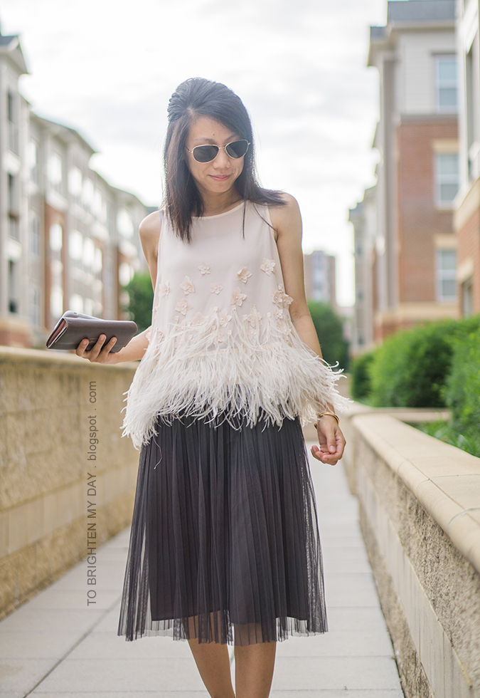 feathered fringe sleeveless top, dark gray tulle midi skirt, rose gold cuff, taupe clutch