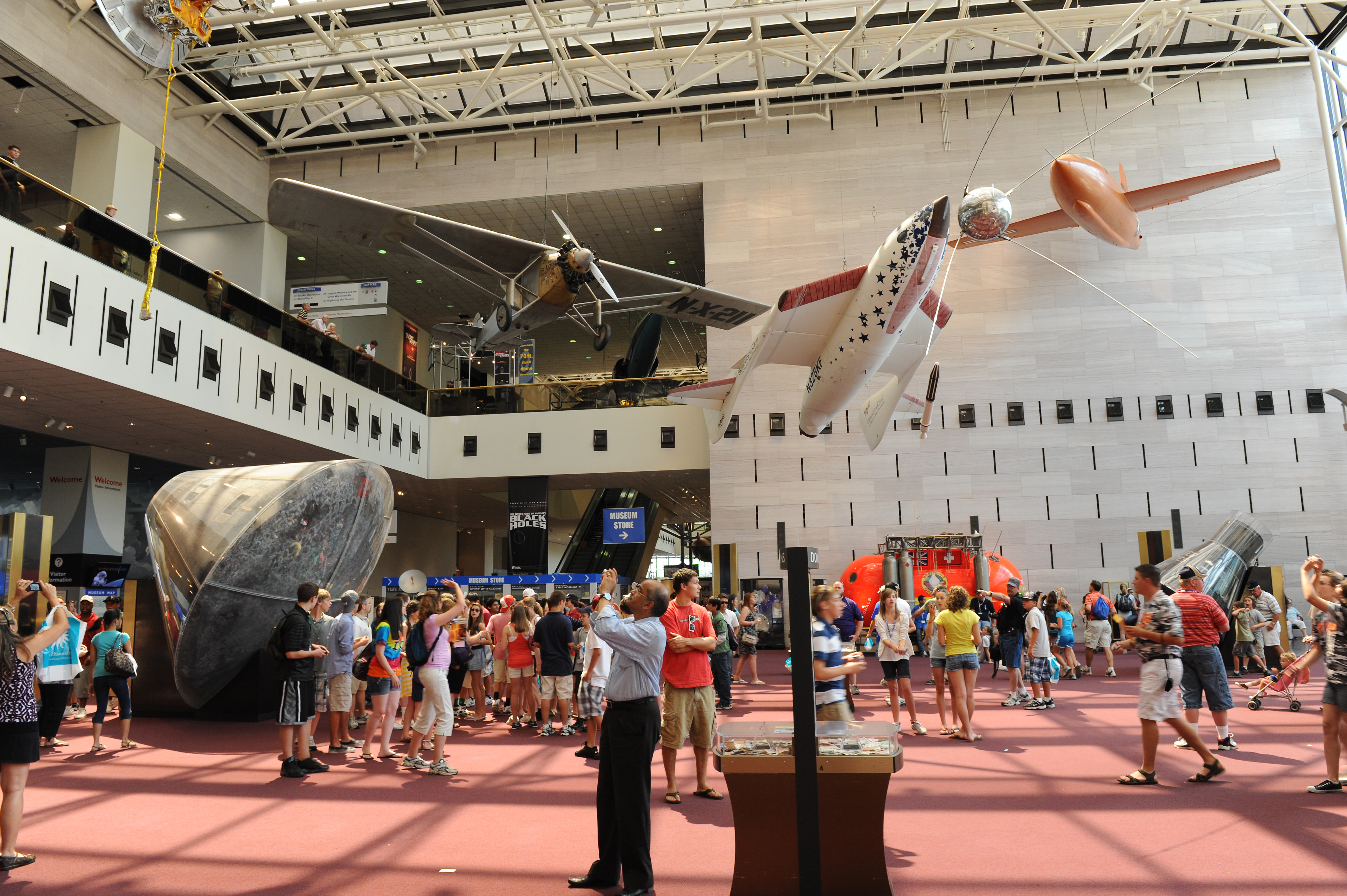 The entrance hall of the National Air and Space Museum in Washington, DC. Among the visible aircraft are Spirit of The St. Louis, the Apollo 11 command module, Space Ship One, and X-1. Photo taken by Jawed Karim on June 11, 2010.