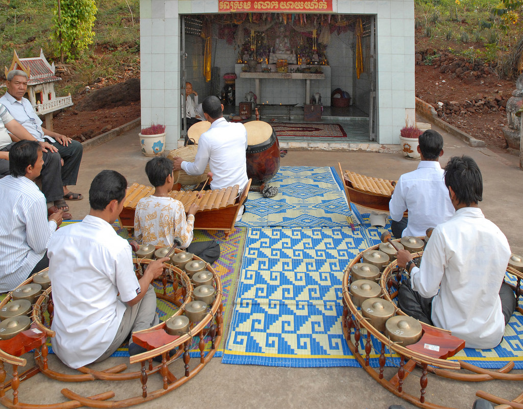 A pinpeat ensemble performing at a small shrine in Cambodia.