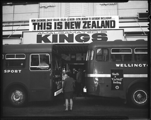<p>Produced by the National Film Unit<br /> Black and white still photograph<br /> 12 x 10 cm cellulose acetate negative<br /> <br /> Catalogue synopsis of film: The film has no spoken commentary. It is designed to give a comprehensive look at where New Zealand is located in the world, what the country is like and what it produces. It shows New Zealanders at work and play. Sequences from the film include spectacular panoramas, covering the three screens, of aerial scenes over the Southern Alps and over farmlands and cities. Combined aerial sequences with separate scenes on each screen, give an idea of the contrasts of the New Zealand countryside. This setting leads into sequences showing farming, sheep in large numbers, farming research, cattle mustering and dairy production. Forestry development and milling and export of logs to Japan are shown, followed by sequences of New Zealanders at their normal work – builders, barristers, dentists school teachers, doctors and hospital workers are shown followed by items about social services and infants. The new Zealanders keen interest in sport is depicted in a wide variety. The film ends on a scenic note, returning to spectacular aerial views<br /> <br /> Archives New Zealand Reference: AAPG 24449 W3939 box 5 <br /> <br /> For further enquiries email research.archives@dia.govt.nz<br /> <br /> Material from Archives New Zealand Te Rua Mahara o te Kāwanatanga</p>