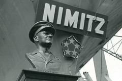 A bust of Adm. Chester Nimitz is revealed at the commissioning of the ship on May 3, 1975. (U.S. Navy)