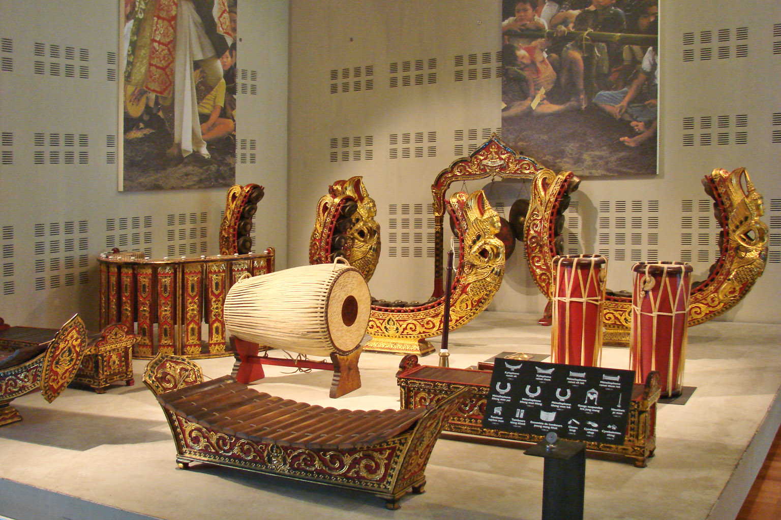 Instruments of a piphat mon orchestra exhibited at the Cité de la Musique, Paris, France. The piphat mon is believed to derive from the Mon people, an ancient Mon-Khmer-speaking people of mainland Southeast Asia, and uses special instruments such as an upright gong circle called khong mon. Wong piphat mon (วงปี่พาทย์มอญ) has three types, based on the number and kinds of instruments - piphat mon khrueang ha, piphat mon khrueang khu and piphat mon khrueang yai Photo taken by Jean-Pierre Dalbéra on July 29, 2009.