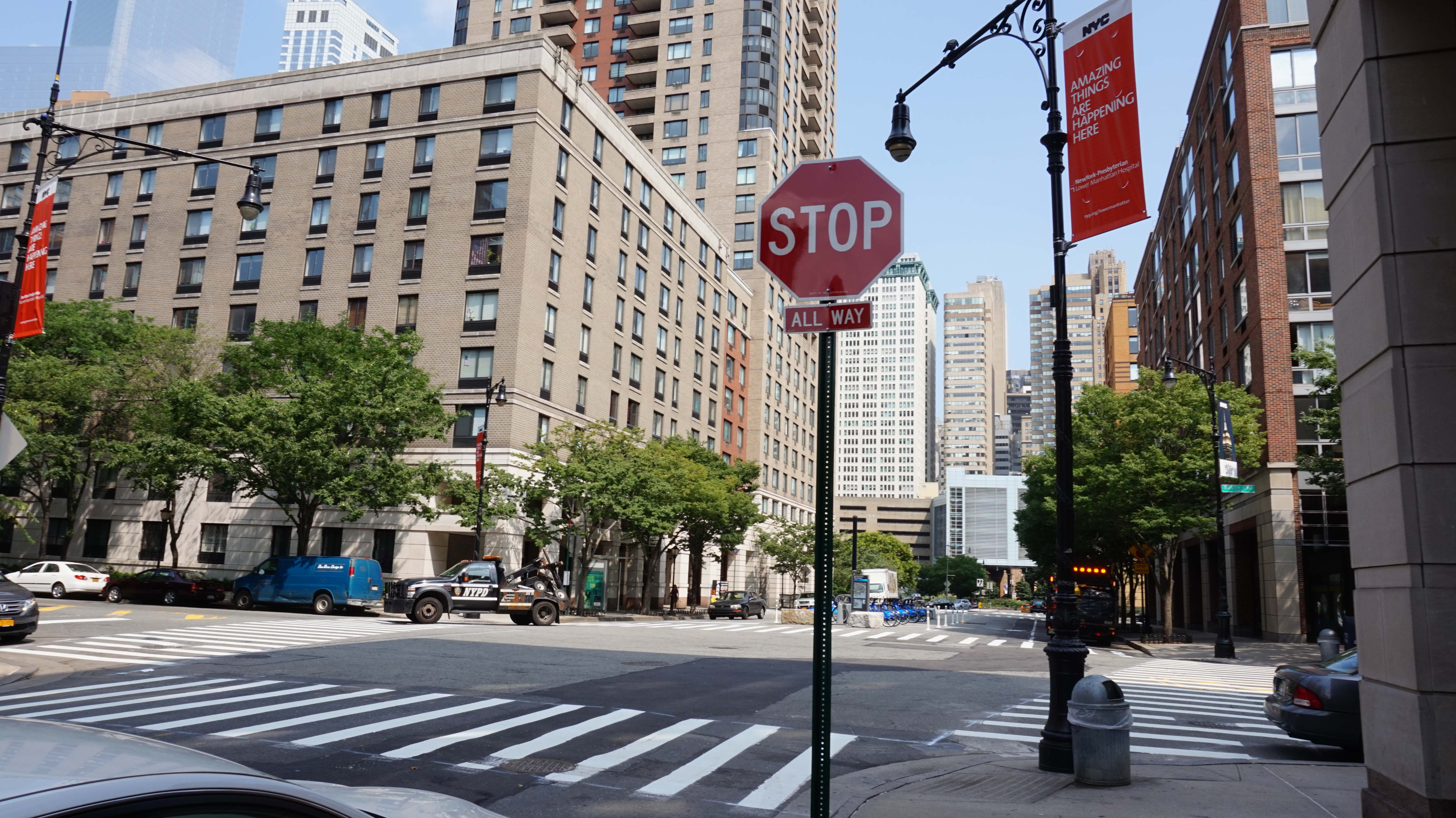 Stop sign at the southwest corner of West Thames and South End in New York City. Photo taken on July 22, 2014.