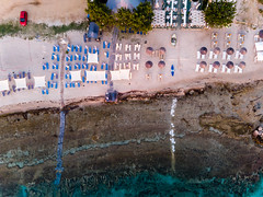 Bird's eye view of the beach in Afitos at sunset