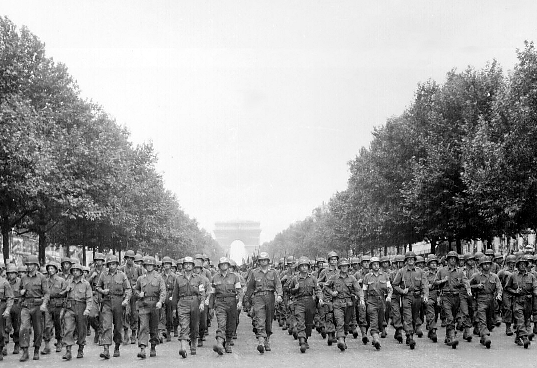American troops of the 28th Infantry Division march down the Avenue des Champs-Élysées, Paris, in the `Victory' Parade on August 26, 1944.
